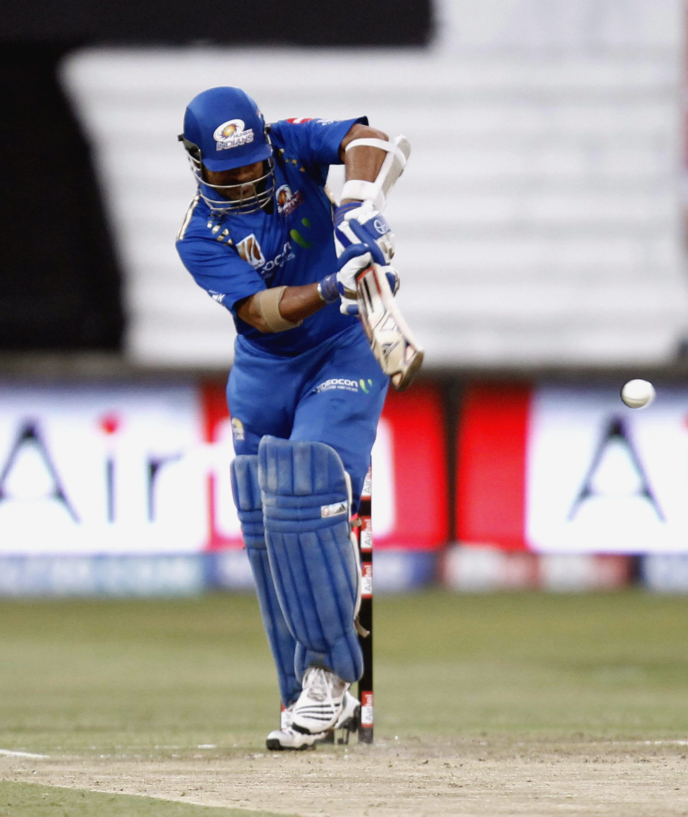 DURBAN, SOUTH AFRICA - SEPTEMBER 19: Sachin Tendulkar of the Mumbai Indians of hits out during the Airtel Champions League Twenty20 match between Mumbai Indians and Royal Challengers Bangalore at Sahara Stadium Kingsmead on September 19, 2010 in Durban, S