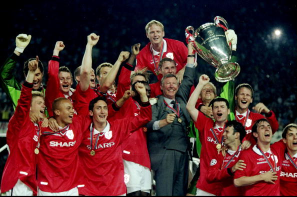 26 May 1999:  Manchester United celebrate with the trophy after their 2-1 victory over Bayern Munich in the UEFA Champions League Final at the Nou Camp in Barcelona, Spain.  \ Mandatory Credit: Phil Cole /Allsport