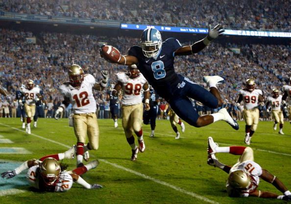 CHAPEL HILL, NC - OCTOBER 22:  Greg Little #8 of the North Carolina Tar Heels dives past Florida State Seminole defenders for a first quarter touchdown at Kenan Stadium on October 22, 2009 in Chapel Hill, North Carolina.  (Photo by Scott Halleran/Getty Im