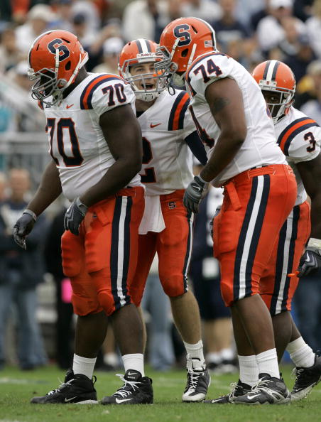STATE COLLEGE, PA - SEPTEMBER 12: Quarterback Greg Paulus #2 of the Syracuse Orangemen shouts to his linemen Ryan Bartholomew #70, Nick Speller #74, and running back Delone Carter #3 during the second half against the Penn State Nittany Lions at Beaver St