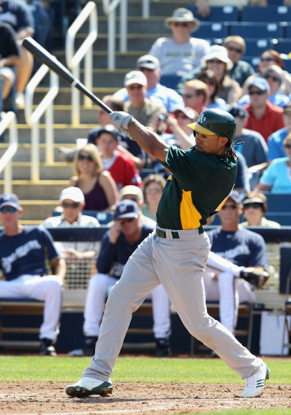 PHOENIX, AZ - MARCH 03:  Coco Crisp #4 of the Oakland Athletics hits a RBI single against the Milwaukee Brewers during the second inning of the spring training game at Maryvale Baseball Park on March 3, 2011 in Phoenix, Arizona.  (Photo by Christian Peter