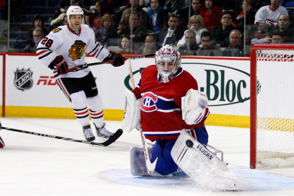MONTREAL, CANADA - APRIL 5:  Carey Price #31 of the Montreal Canadiens makes a pad save on the puck during the NHL game against the Chicago Blackhawks at the Bell Centre on April 5, 2011 in Montreal, Quebec, Canada.  The Canadiens defeated the Blackhawks