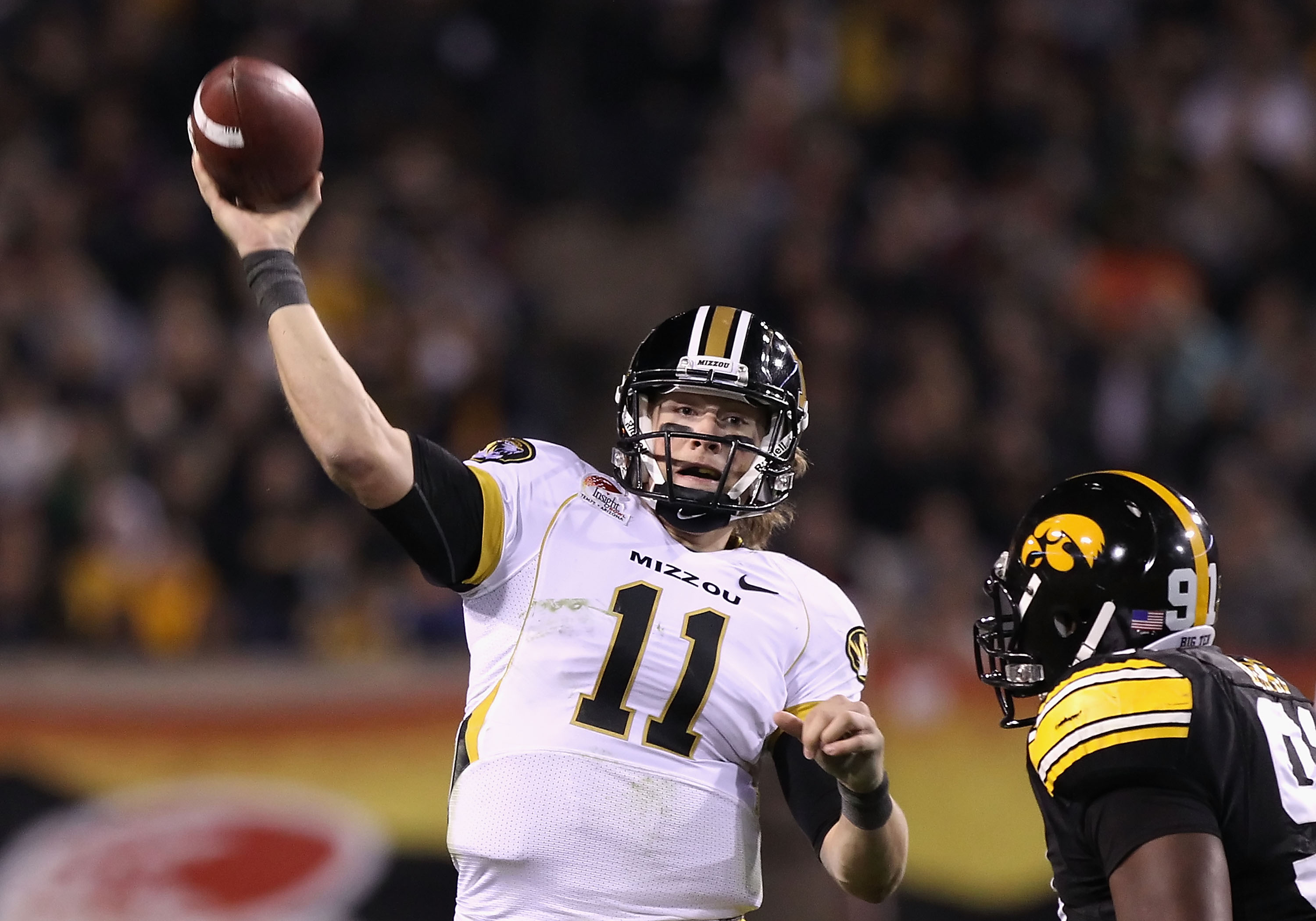 TEMPE, AZ - DECEMBER 28:  Quarterback Blaine Gabbert #11 of the Missouri Tigers throws a pass during the Insight Bowl against the Iowa Hawkeyes at Sun Devil Stadium on December 28, 2010 in Tempe, Arizona.  The Hawkeyes defeated the Tigers 27-24. (Photo by