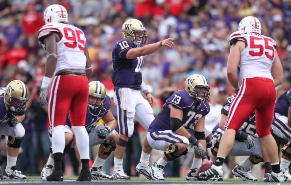 SEATTLE - SEPTEMBER 18: Quarterback Jake Locker #10 of the Washington Huskies points at the line of scrimmage against the Nebraska Cornhuskers on September 18, 2010 at Husky Stadium in Seattle, Washington. (Photo by Otto Greule Jr/Getty Images)