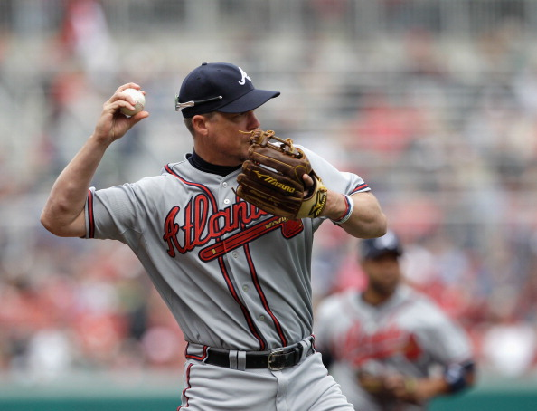 WASHINGTON, DC - APRIL 03:  Third baseman Chipper Jones #10 of the Atlanta Braves makes a throw against the Washington Nationals at Nationals Park on April 3, 2011 in Washington, DC.  (Photo by Rob Carr/Getty Images)