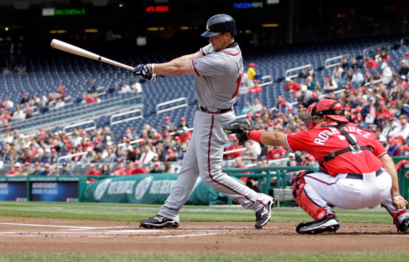 WASHINGTON, DC - APRIL 03: Catcher Ivan Rodriguez #7 of the Washington Nationals looks on a Chipper Jones #10 of the Atlanta Braves follows through on swing at Nationals Park on April 3, 2011 in Washington, DC.  (Photo by Rob Carr/Getty Images)