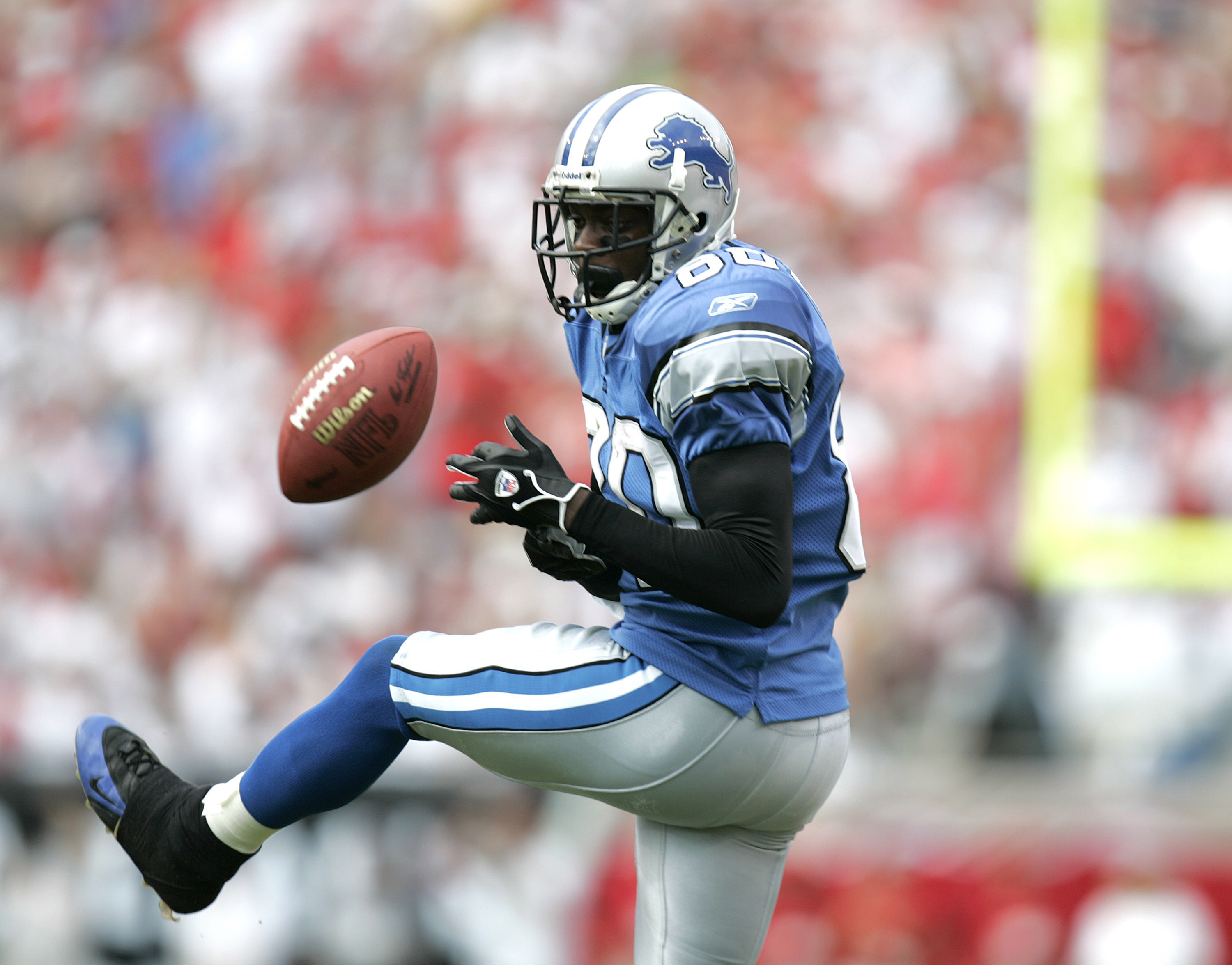 Detroit Lions wide receiver Charles Rogers (80) drops a pass during the fourth quarter against Tampa Bay at Raymond James Stadium in Tampa, Florida on October 2, 2005. Tampa Bay defeated Detroit 17-13. (Photo by Allen Kee/Getty Images)