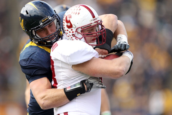 BERKELEY, CA - NOVEMBER 20:  Konrad Reuland #88 of the Stanford Cardinal is tackled by Mike Mohamed #18 of the California Golden Bears at California Memorial Stadium on November 20, 2010 in Berkeley, California.  (Photo by Ezra Shaw/Getty Images)