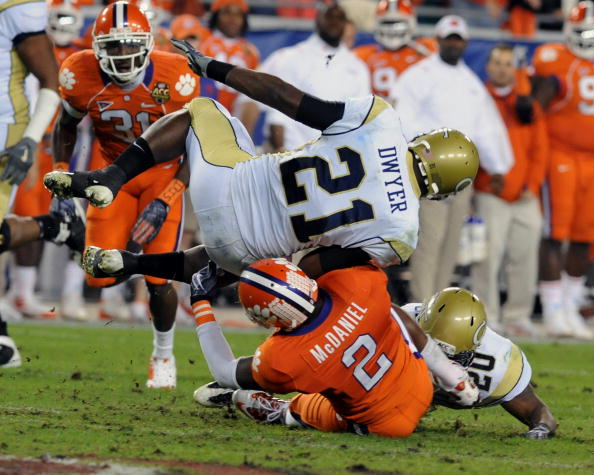 TAMPA, FL - DECEMBER 5: Running back Jonathan Dwyer #21 of the Georgia Tech Yellow Jackets tumbles for a gain against DeAndre McDaniel #2 of the Clemson Tigers in the 2009 ACC Football Championship Game December 5, 2009 at Raymond James Stadium in Tampa,