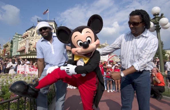 LAKE BUENA VISTA, FL - OCTOBER 29:  Boston Red Sox pitcher Pedro Martinez (R) and slugger David Ortiz (L) check out Mickey Mouse's red socks after a parade at Walt Disney World October 29, 2004 in Lake Buena Vista, Florida. Hundreds of fans turned out to