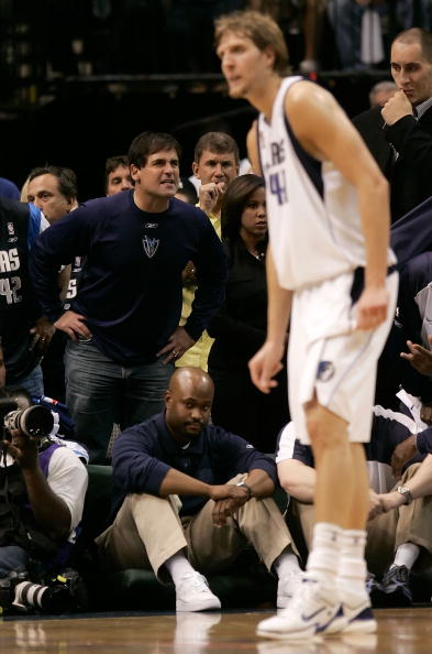 DALLAS - JUNE 20:  Owner Mark Cuban of the Dallas Mavericks yells to the court as Dirk Nowitzki #41 of the Mavericks stands in the foreground in game six of the 2006 NBA Finals against the Miami Heat on June 20, 2006 at American Airlines Center in Dallas,