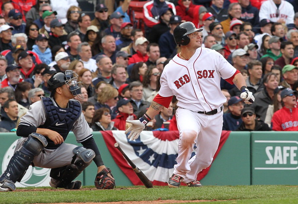 BOSTON, MA - APRIL 8:   Jarrod Saltalamacchia #39 of the Boston Red Sox knocks in the go-ahead run, scored by Kevin Youkilis #20, against the New York Yankees in the fifth inning on Opening Day at Fenway Park on April 8, 2011 in Boston, Massachusetts. (Ph