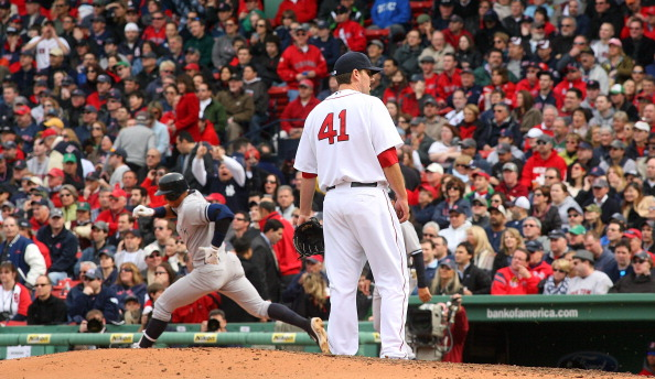 BOSTON, MA - APRIL 8:  John Lackey #41 of the Boston Red Sox reacts as Alex Rodriguez #13 of the New York Yankees rounds the bases after hitting a home run in the fifth inning against the Boston Red Sox during opening game at Fenway Park, April 8, 2011 in