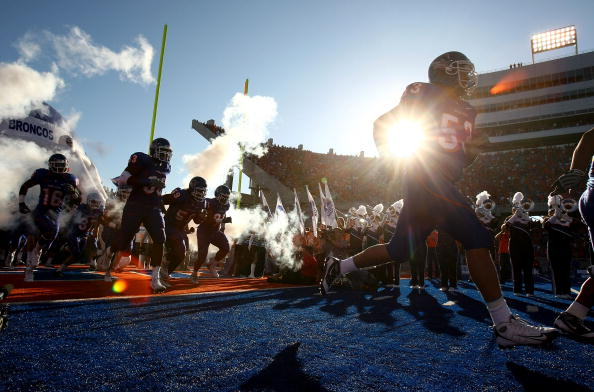 BOISE , ID - SEPTEMBER 13: Players of the Boise State Broncos run onto the field before the start of the game against the Bowling Green Falcons at Bronco Stadium on September 13, 2008 in Boise, Idaho. (Photo by Jonathan Ferrey/Getty Images)