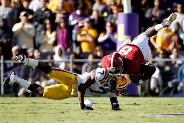 BATON ROUGE, LA - NOVEMBER 06:  Julio Jones #8 of the Alabama Crimson Tide is tackled by Patrick Peterson #7 of the Louisiana State University Tigers at Tiger Stadium on November 6, 2010 in Baton Rouge, Louisiana.  (Photo by Chris Graythen/Getty Images)