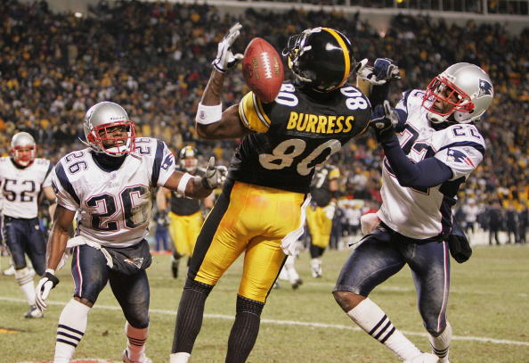 PITTSBURGH - JANUARY 23:  Defensive backs Eugene Wilson #26 and Asante Samuel #22 of the New England Patriots defend as a pass goes through the hands of wide receiver Plaxico Burress #80 of the Pittsburgh Steelers in the AFC championship game at Heinz Fie