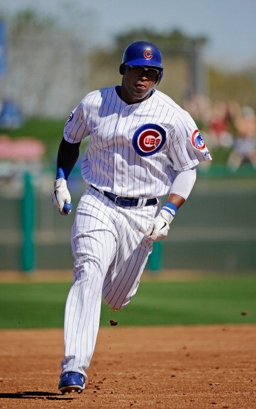 MESA, AZ - MARCH 09:  Marlon Byrd #24 of the Chicago Cubs runs the bases after hitting a solo home run against the Kansas City Royals in the third inning against during the spring training baseball game at HoHoKam Stadium on March 9, 2011 in Mesa, Arizona