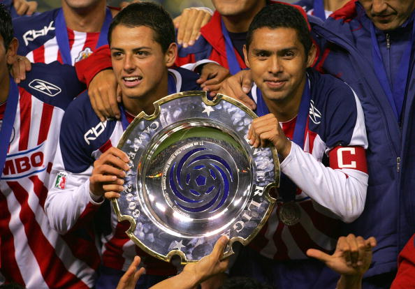 CARSON, CA - JANUARY 11:  Captain Ramon Morales #11 and Javier Hernandez #14 of CD Chivas de Guadalajara hold up the InterLiga trophy for a photo after defeating Morelia 4-2 on penalty kicks after a 1-1 draw in regulation during their InterLiga match at T