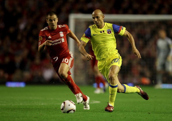 LIVERPOOL, ENGLAND - SEPTEMBER 16 :  Joe Cole of Liverpool competes with Stanislav Angelov of Steaua Bucharest during the UEFA Europa League Group K match beteween Liverpool and Steaua Bucharest at Anfield on September 16, 2010 in Liverpool, England.  (Ph