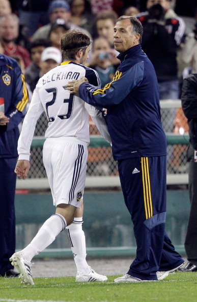 WASHINGTON, DC - APRIL 09:  David Beckham #23 of the Los Angeles Galaxy is patted on the back by head coach Bruce Arena against the D.C. United during the second half at RFK Stadium on April 9, 2011 in Washington, DC. The game ended in a 1-1  draw. (Photo
