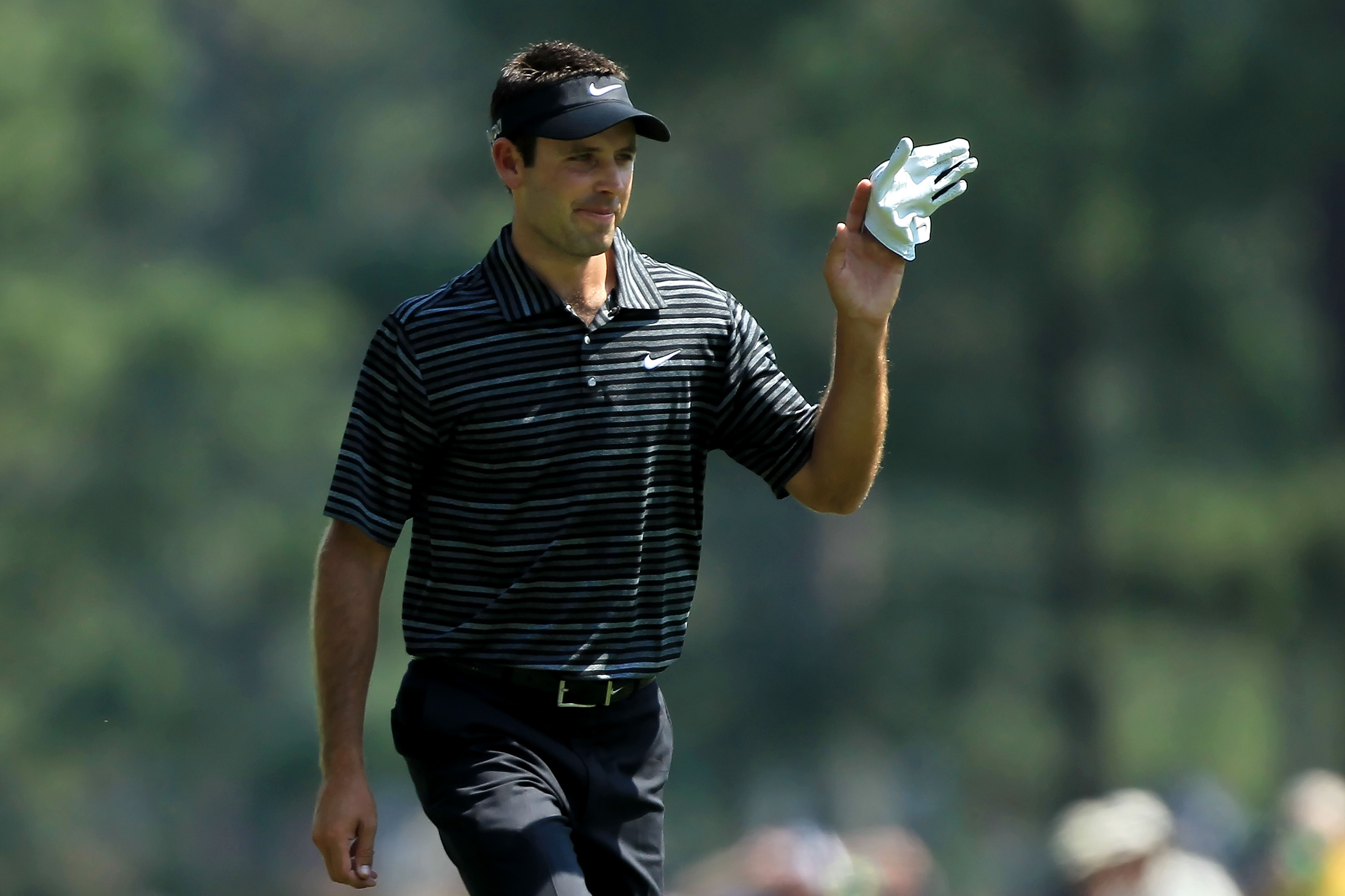 AUGUSTA, GA - APRIL 10:  Charl Schwartzel of South Africa waves to the gallery after holing a shot for eagle on the third green during the final round of the 2011 Masters Tournament on April 10, 2011 in Augusta, Georgia.  (Photo by David Cannon/Getty Imag