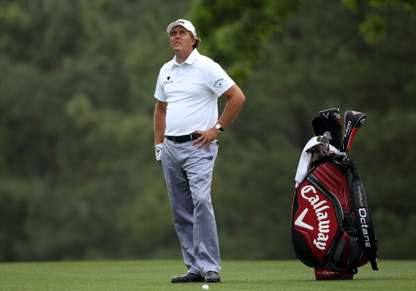 AUGUSTA, GA - APRIL 09:  Phil Mickelson waits to play his approach shot on the first hole during the third round of the 2011 Masters Tournament at Augusta National Golf Club on April 9, 2011 in Augusta, Georgia.  (Photo by Andrew Redington/Getty Images)