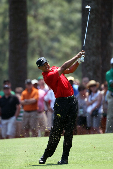 AUGUSTA, GA - APRIL 10:  Tiger Woods plays a shot in the first fairway during the final round of the 2011 Masters Tournament at Augusta National Golf Club on April 10, 2011 in Augusta, Georgia.  (Photo by Jamie Squire/Getty Images)