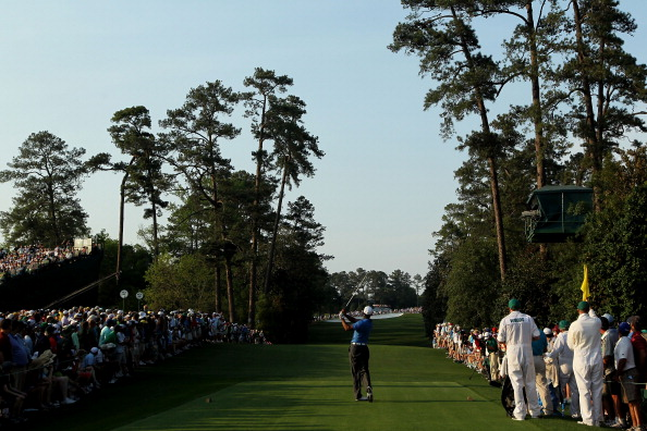AUGUSTA, GA - APRIL 09:  Tiger Woods hits his tee shot on the 18th hole during the third round of the 2011 Masters Tournament at Augusta National Golf Club on April 9, 2011 in Augusta, Georgia.  (Photo by Jamie Squire/Getty Images)