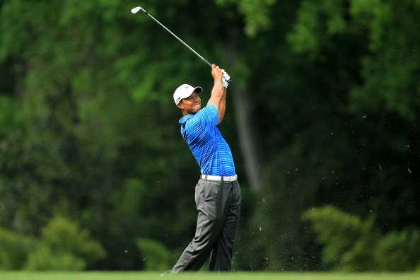 AUGUSTA, GA - APRIL 09:  Tiger Woods hits his approach shot on the fifth hole during the third round of the 2011 Masters Tournament at Augusta National Golf Club on April 9, 2011 in Augusta, Georgia.  (Photo by David Cannon/Getty Images)