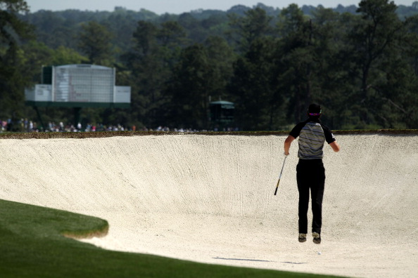 AUGUSTA, GA - APRIL 10:  Rory McIlroy of Northern Ireland leaps in a bunker on the second hole during the final round of the 2011 Masters Tournament on April 10, 2011 in Augusta, Georgia.  (Photo by David Cannon/Getty Images)