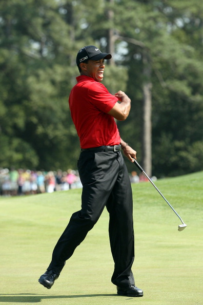 AUGUSTA, GA - APRIL 10:  Tiger Woods celebrates after holing a putt for eagle on the eighth green during the final round of the 2011 Masters Tournament on April 10, 2011 in Augusta, Georgia.  (Photo by Andrew Redington/Getty Images)