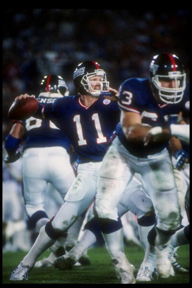 25 Jan 1987:  Quarterback Phil Simms of the New York Giants passes the ball during Super Bowl XXI against the Denver Broncos at the Rose Bowl in Pasadena, California.  The Giants won the game, 39-20. Mandatory Credit: Allsport  /Allsport