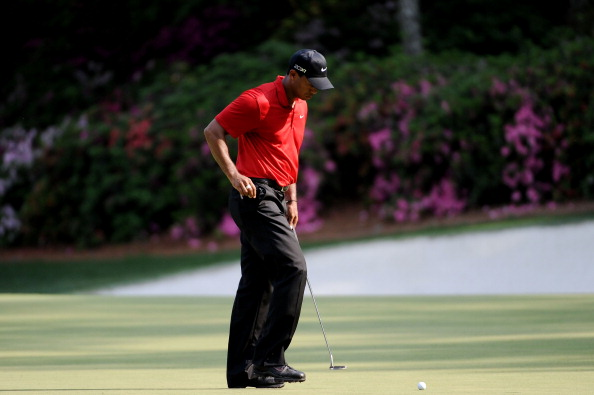AUGUSTA, GA - APRIL 10:  Tiger Woods reacts to a missed putt on the 13th green during the final round of the 2011 Masters Tournament at Augusta National Golf Club on April 10, 2011 in Augusta, Georgia.  (Photo by Harry How/Getty Images)