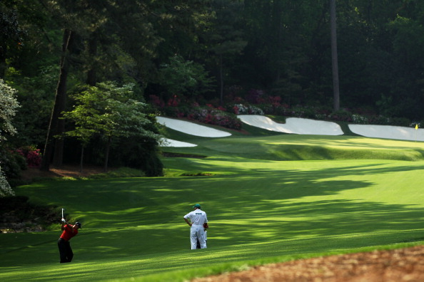 AUGUSTA, GA - APRIL 10:  Tiger Woods plays his second shot on the 13th hole as his caddie Steve Williams looks on during the final round of the 2011 Masters Tournament at Augusta National Golf Club on April 10, 2011 in Augusta, Georgia.  (Photo by Jamie S