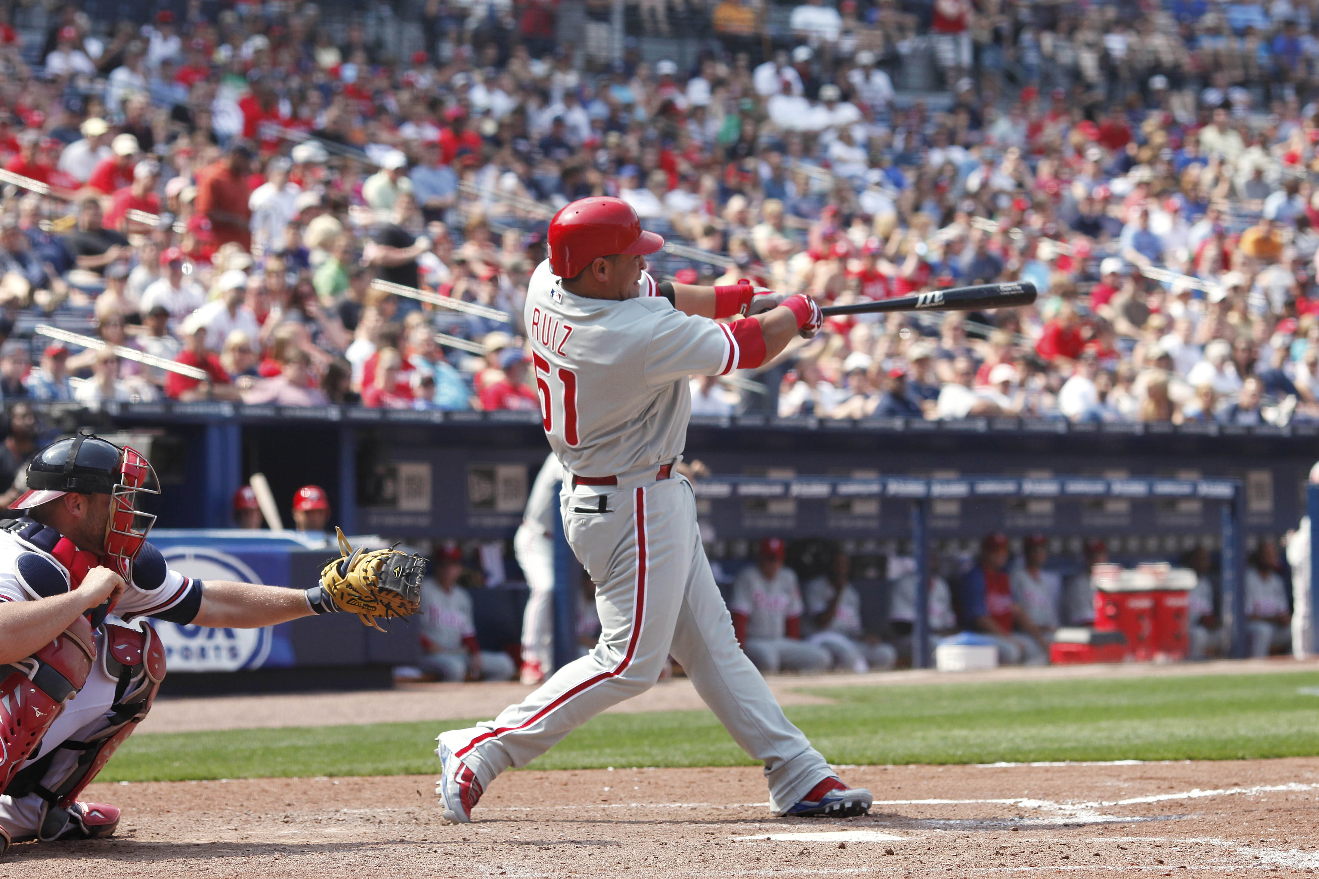 ATLANTA, GA - APRIL 9: Carlos Ruiz #51 of the Philadelphia Phillies drives in a run in the 8th inning with a double against the Atlanta Braves at Turner Field on April 9, 2011 in Atlanta, Georgia. The Phillies won 10-2. (Photo by Joe Robbins/Getty Images)