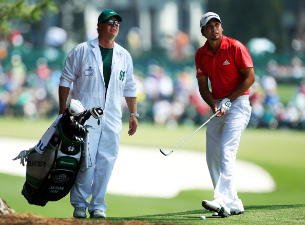 AUGUSTA, GA - APRIL 10:  Jason Day of Australia chats with his caddie Colin Swatton on the first hole during the final round of the 2011 Masters Tournament at Augusta National Golf Club on April 10, 2011 in Augusta, Georgia.  (Photo by Jamie Squire/Getty