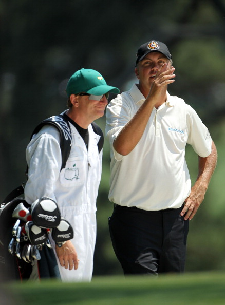 AUGUSTA, GA - APRIL 10:  Bo Van Pelt chats with his caddie Mark Chaney on the first hole during the final round of the 2011 Masters Tournament at Augusta National Golf Club on April 10, 2011 in Augusta, Georgia.  (Photo by Jamie Squire/Getty Images)