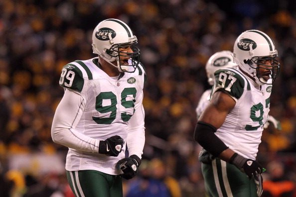PITTSBURGH, PA - JANUARY 23:  Jason Taylor #99 of the New York Jets reacts after sacking Ben Roethlisberger #7 of the Pittsburgh Steelers as Calvin Pace #97 of the New York Jets looks on during the 2011 AFC Championship game at Heinz Field on January 23,