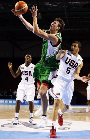 AUCKLAND, NEW ZEALAND - JULY 08:  Donatas Motiejunas of Lithuania takes the ball to the hoop as Seth Curry of the United States defends during the U19 Basketball World Championships match between the United States and Lithuania at North Shore Events Centr