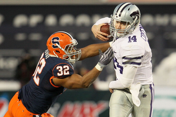 NEW YORK, NY - DECEMBER 30:  Carson Coffman #14 of the Kansas State Wildcats gets out of the tackle of Doug Hogue #32 of the Syracuse Orange during the New Era Pinstripe Bowl at Yankee Stadium on December 30, 2010 in New York, New York.  (Photo by Chris M