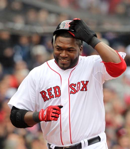BOSTON, MA - APRIL 8:  David Ortiz #34 of the Boston Red Sox reacts after scoring a run against the New York Yankees during Opening Day at Fenway Park on April 8, 2011 in Boston, Massachusetts. (Photo by Jim Rogash/Getty Images)