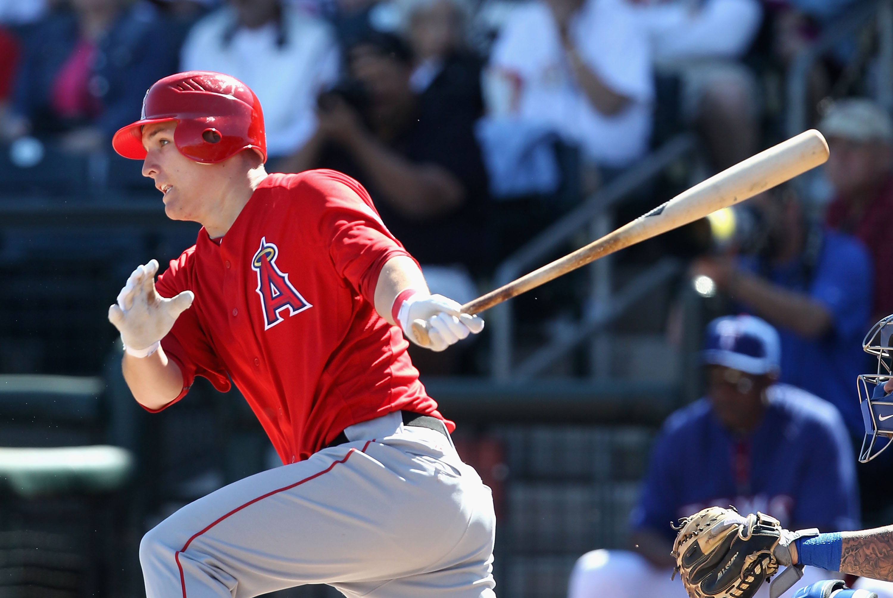 SURPRISE, AZ - MARCH 02:  Mike Trout #90 of the Los Angeles Angels of Anaheim hits a single against the Texas Rangers during the second inning of the spring training game at Surprise Stadium on March 2, 2011 in Surprise, Arizona.  (Photo by Christian Pete