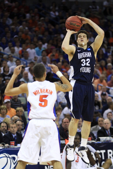NEW ORLEANS, LA - MARCH 24:  Jimmer Fredette #32 of the Brigham Young Cougars shoots over Scottie Wilbekin #5 of the Florida Gators in the second half during the Southeast regional of the 2011 NCAA men's basketball tournament at New Orleans Arena on March