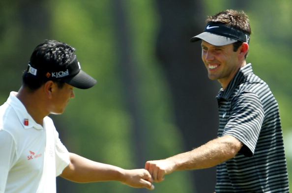 AUGUSTA, GA - APRIL 10:  Charl Schwartzel of South Africa (R) celebrates with K.J. Choi of South Korea after Schwartzel holed a shot for eagle on the third green during the final round of the 2011 Masters Tournament on April 10, 2011 in Augusta, Georgia.