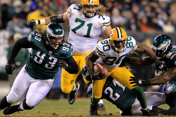PHILADELPHIA, PA - JANUARY 09:  Donald Driver #80 of the Green Bay Packers tries to avoid the tackle of Trevor Laws #93 Joselio Hanson #21, Jamar Chaney #51 and Keenan Clayton #57 of the Philadelphia Eagles and   during the 2011 NFC wild card playoff game