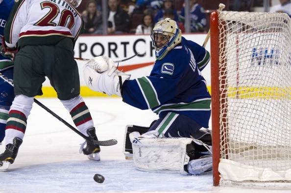 VANCOUVER, CANADA - APRIL 7: Goalie Roberto Luongo #1 of the Vancouver Canucks watches the puck slide across the front of his net from a Minnesota Wild shot during the third period in NHL action on April 07, 2011 at Rogers Arena in Vancouver, BC, Canada.