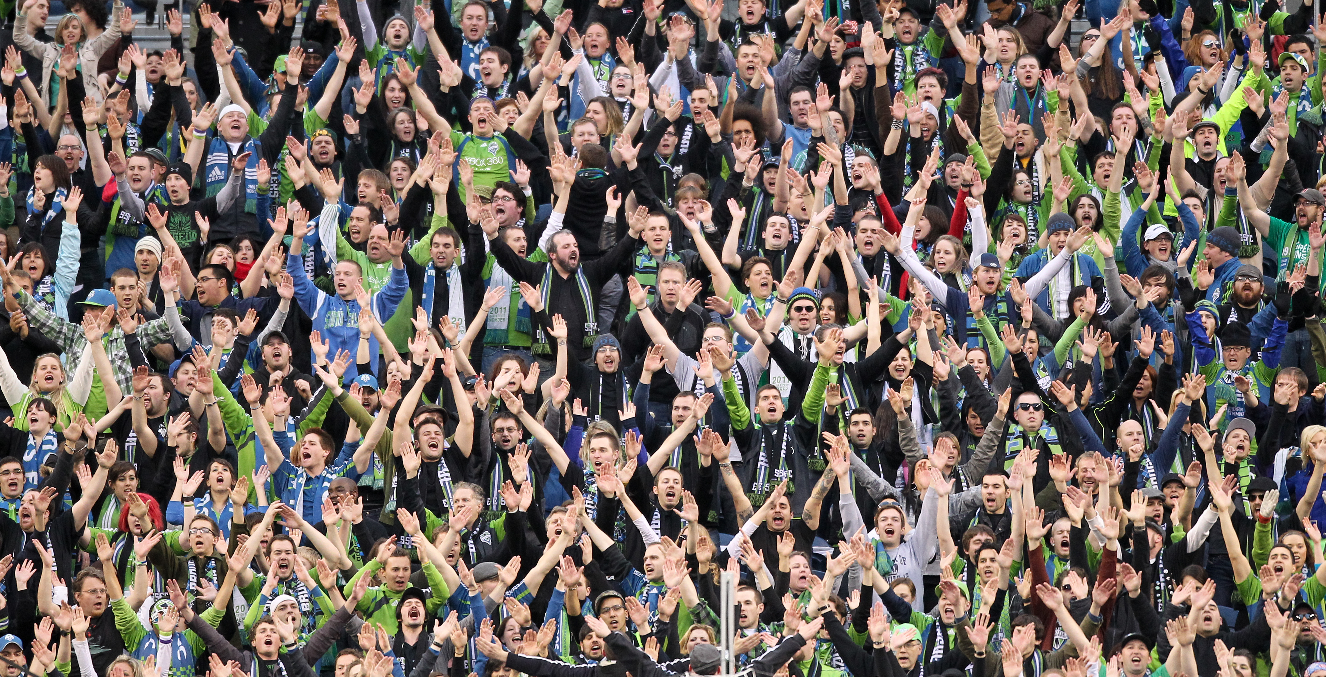 SEATTLE, WA - MARCH 25:  Fans of the Seattle Sounders FC cheer during the game against the Houston Dynamo at Qwest Field on March 25, 2011 in Seattle, Washington. (Photo by Otto Greule Jr/Getty Images)