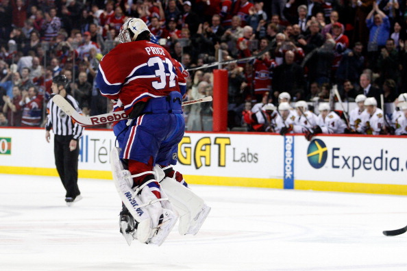 MONTREAL, CANADA - APRIL 5:  P.K. Subban #76 of the Montreal Canadiens and Carey Price #31 jump into each other after defeating the Chicago Blackhawks and clinching a playoff position during the NHL game at the Bell Centre on April 5, 2011 in Montreal, Qu