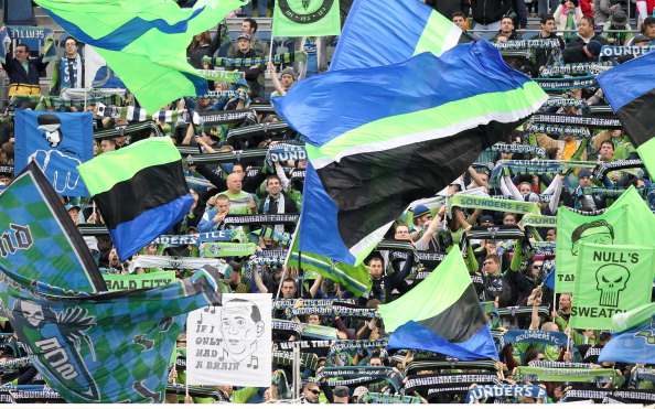 SEATTLE, WA - MARCH 25:  Fans of the Seattle Sounders FC wave flags prior to the game against the Houston Dynamo at Qwest Field on March 25, 2011 in Seattle, Washington. (Photo by Otto Greule Jr/Getty Images)