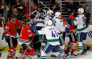 CHICAGO - MARCH 05:  A melee breaks out between the Chicago Blackhawks and the Vancouver Canucks in the first minute of play after Andrew Ladd of the Blackhawks and Ryan Kesler of the Canucks start a fight at the United Center on March 5, 2010 in Chicago,